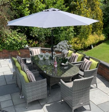 8 Manhattan Armchairs 2.2 mtr Oval Set in Grey mix weave Parasol & Cushions