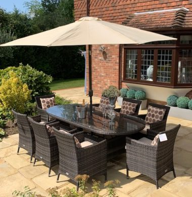 8 Manhattan Armchairs 2.2 mtr Oval Set in Black/Brown mix Parasol & Cushions