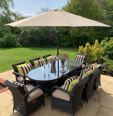 8 Savannah Armchairs 2.2 mtr Oval Set in Black/Brown weave Parasol & Cushions Inc