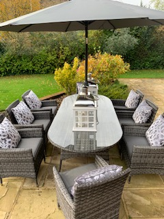8 Manhattan Armchairs 2.2 mtr Oval Set in Grey/Black mix weave Parasol & Cushions